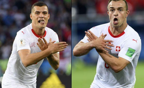 Kosovon albaanitaustaiset Granit Xhaka ja Xherdan Shaqiri ristivät kätensä kaksipäisen kotkan symboliksi maaliensa jälkeen.