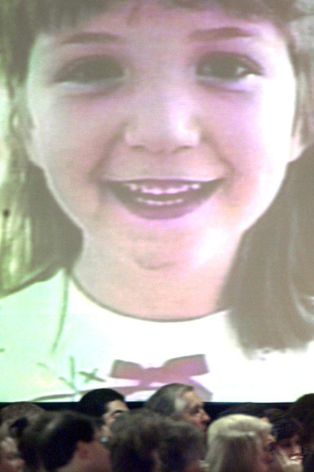 Rachel Scottin kuva heijastettiin seinälle hänen hautajaisissaan vuonna 1999.