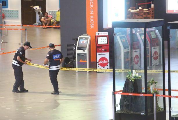 Malesian poliisi rekonstruoi Kim Jong-namin murhan Kuala Lumpurin lentokentällä perjantaina.