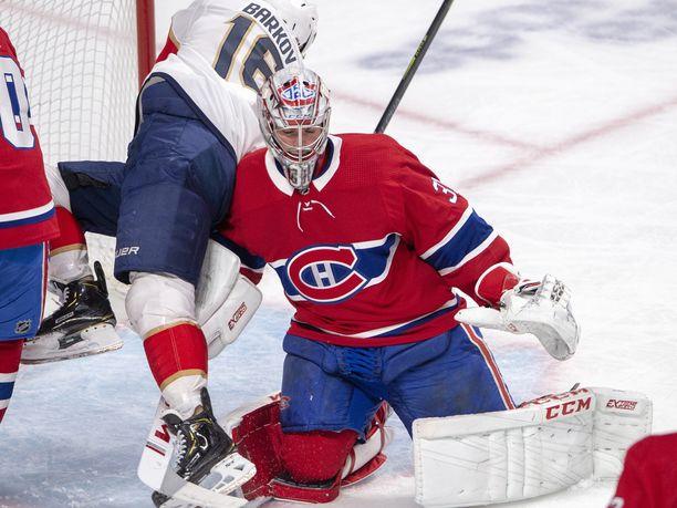 Aleksandr Barkov törmäsi Canadiensin tähtivahtiin Carey Priceen.