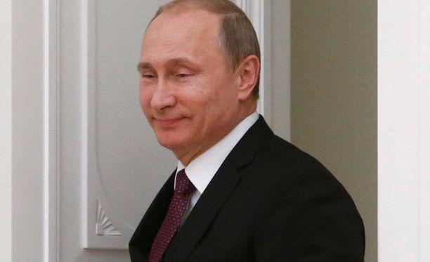 Vladimir Putin näki Fifan toimihenkilöiden pidätykset Yhdysvaltojen yrityksenä laajentaa toimivaltaansa.