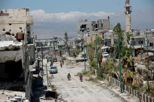 Syyrialaislääkäri toimi Homsin sotilassairaalassa. Kuvassa Qusairin kaupungin pääaukio Homsin maakunnassa.