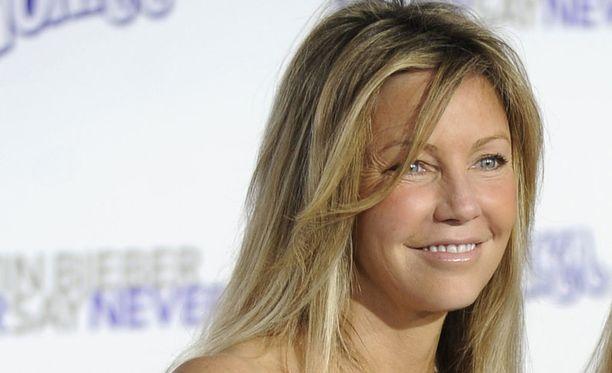 Yhdysvaltalaisnäyttelijä Heather Locklear uhkasi ampua itsensä, kertoo viihdesivusto TMZ. Kuvassa Locklear helmikuussa 2011.