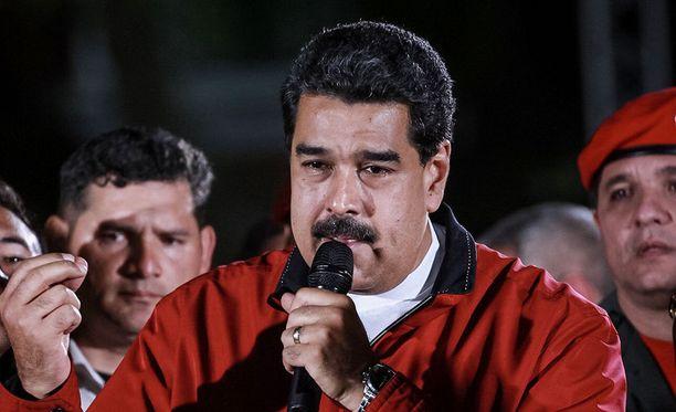 Oppositio pitää lakimuutosta presidentti Nicolas Maduron (kuvassa) keinona vahvistaa asemaansa.