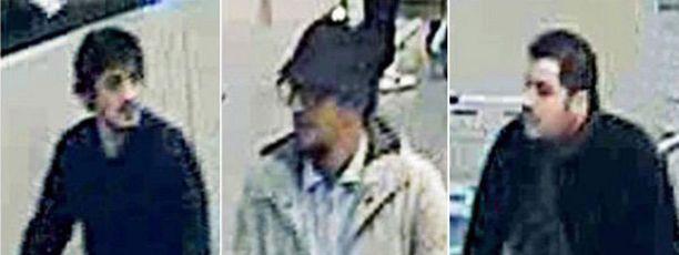Belgian poliisi etsintäkuulutti illalla hattupäisen miehen (kesk.), jolla on silmälasit ja parta.