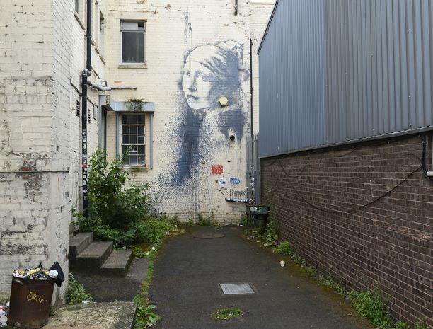 Banksyn graffiti taiteilijan todennäköisessä kotikaupungissa Bristolissa, Britanniassa