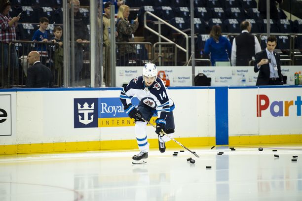 October 03, 2019: Winnipeg Jets defenseman Ville Heinola (14) smiles as he skates out on the ice for the first time during the home opener between The New York Rangers and The Winnipeg Jets at Madison Square Garden in Manhattan, New York. Mandatory credit: Kostas Lymperopoulos/CSM (Credit Image: © Kostas Lymperopoulos/CSM via ZUMA Wire)