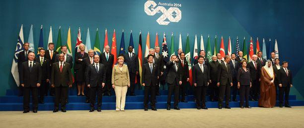 Putin sijoitettiin ryhmäkuvassa alariviin vasempaan laitaan