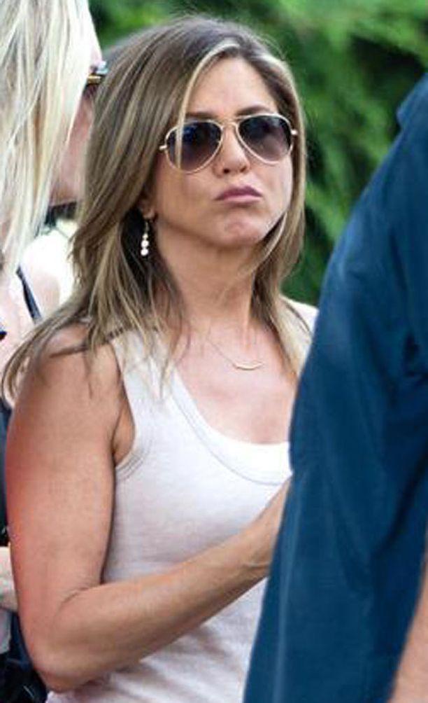 Jennifer Aniston mielletään usein varsin hymyileväksi, vaikka hänetkin monet lukevat resting bitch faceksi.