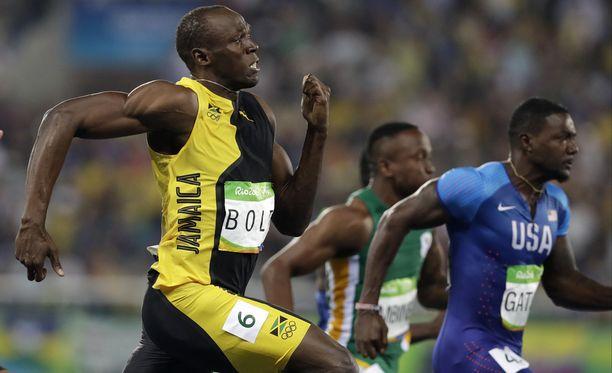 Usain Bolt (edessä) ja Justin Gatlin vakuuttavat, että välit ovat kunnossa.