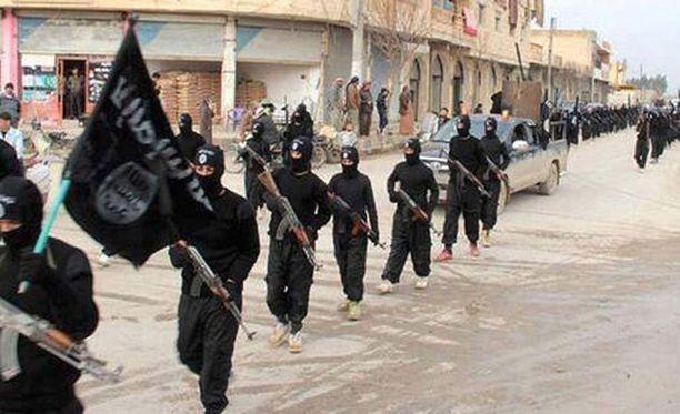 Kuvassa Isis-sotilaat valtaamassa Irakin toiseksi suurinta kaupunkia Mosulia.