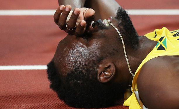 Usain Boltin arvokisaura päättyi keskeytykseen.