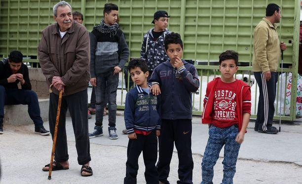 Turvapaikanhakijoita Kreikassa Ateenassa.