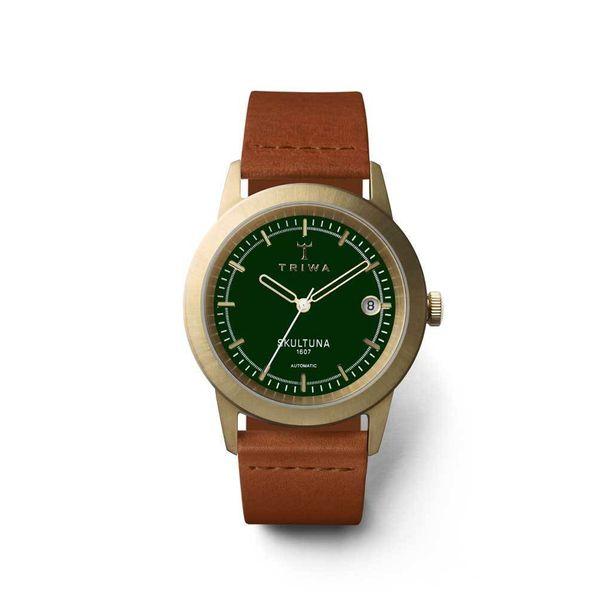 Messinkiosat ja vihreä kellotaulu tekevät kellosta persoonallisen 723aaee0f6