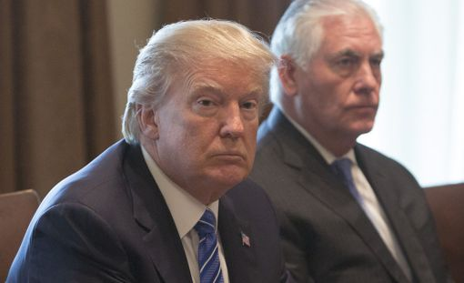 United States President Donald J. Trump (left) and US Secretary of State Rex Tillerson (right) listen during a meeting with Malaysia's Prime Minister Najib Abdul Razak (unseen) at The White House in Washington, DC, September 12, 2017.