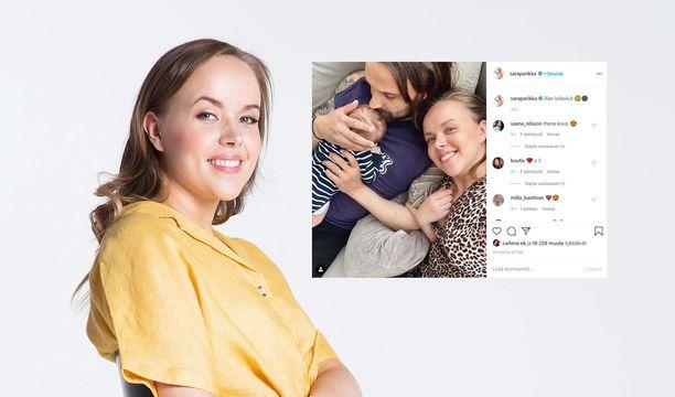Sara ja Mikko Parikka poseeraavat tuoreessa otoksessa kuopuksensa Melinan kanssa.