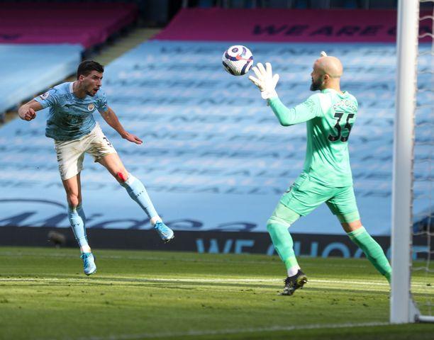 Ruben Dias puski ManchesterCItyn avausmaalin West Hamin verkkoon.