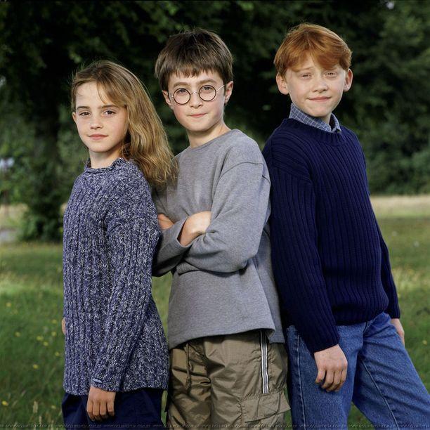 Tältä Harry Potter -tähdet näyttivät elokuvasarjan alkaessa. Vasemmalla Emma Watson, keskellä Daniel Radcliffe ja oikealla Rupert Grint.