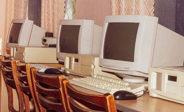 A stylized classic film image of a room with old computers