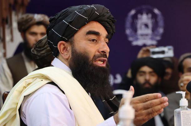 Taliban on vakuutellut, että se ei vainoa vastustajiaan. Käytäntö näyttää toista. Kuvassa Talibanin tiedottaja Zabihullah Mujahid.