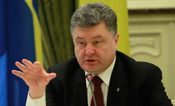 Petro Poroshenko otti kantaa Venäjän vuonna 2018 isännöimän jalkapallon MM-turnauksen suhteen.