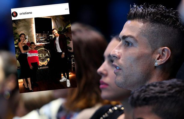 Christiano Ronaldo of Portugal watches court side with his son and girlfriend