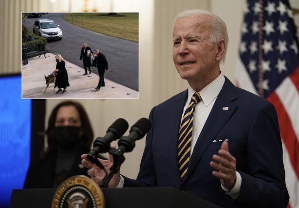 Joe Bidenin Champ kävelee kohti Valkoista taloa.