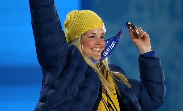 Holmlund juhli olympiapronssia vuonna 2014.