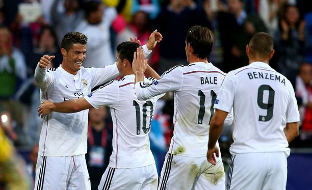 Cristiano Ronaldo (vasemmalla) juhli Realin avausosumaa.