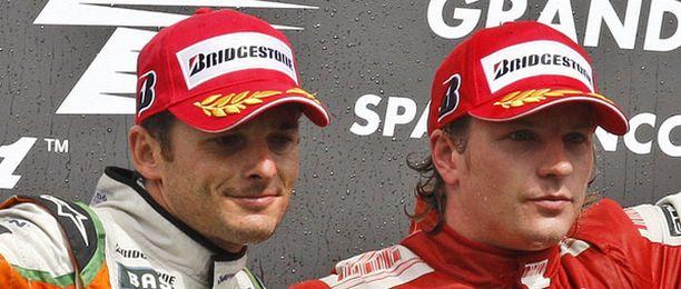 Giancarlo Fisichella (vas.) ja Kimi Räikkönen kilpailivat eri tallien väreissä Belgian GP:ssä. Loppukauden molemmat ajavat Ferrarin väreissä.