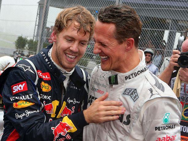 Michael Schumacherilla on ollut suuri vaikutus Sebastian Vettelin uraan. Arkistokuva vuoden 2012 Brasilian GP:stä, jossa Vettel varmisti kolmannen maailmanmestaruutensa ja Schumacher lopetti F1-uransa.