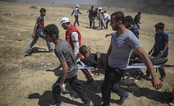 Valkoinen talo pitää Hamasia syypäänä palestiinalaisten mielenosoittajien kuolemiin Gazassa. Israelin armeija on ampunut 52 mielenosoittajaa maanantain aikana.