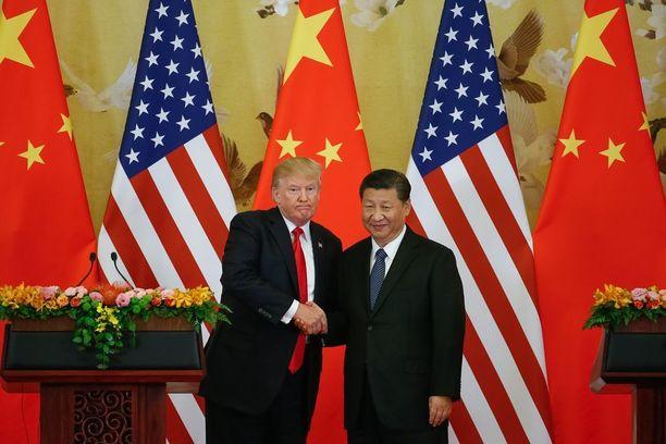 Presidentti Trump ja presidentti Xi paiskasivat kättä Pekingissä.
