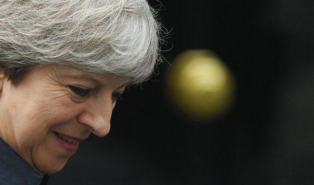 Pääministeri Mayn konservatiivinen puolue menetti paikkoja parlamentissa kesäkuun vaaleissa.