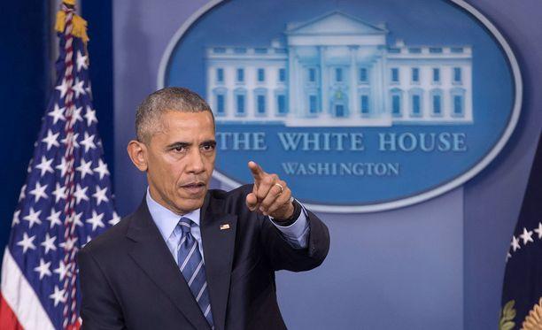 Obama varoitti lehdistötilaisuudessa Trumpia sotkemasta vakiintunutta Kiina-politiikkaa.