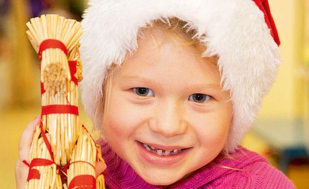 """""""Jouluaattona pitää syödä paljon. Minä tykkään kinkusta ja riisipuurosta."""" Sara, 6"""