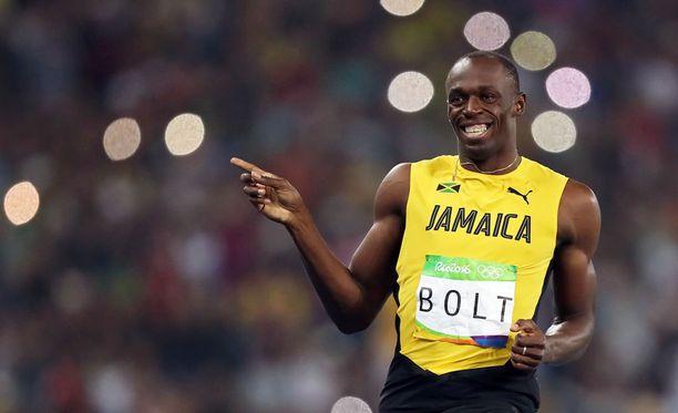 Usain Boltia nauratti 200 metrin välierän jälkeen.