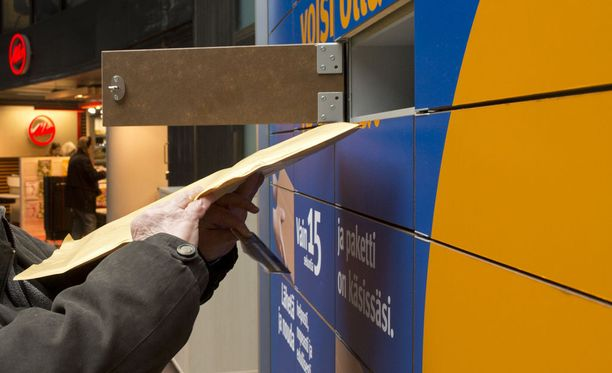 Postin pakettiautomaattien maksupäätteet poistuvat. Kuvituskuva pakettiautomaatista.