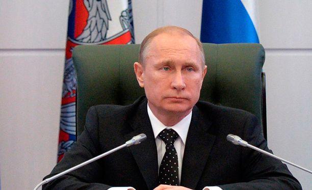 Putin vastasi puheella Krimiä vastaan perjantaina määrättyihin pakotteisiin.