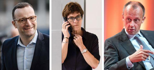 Jens Spahn (vasemmalla), Annegret Kramp-Karrenbauer ja Friedrich Merz ovat monissa arvioissa vahvimmilla Merkelin seuraajaksi puolueen johtoon.