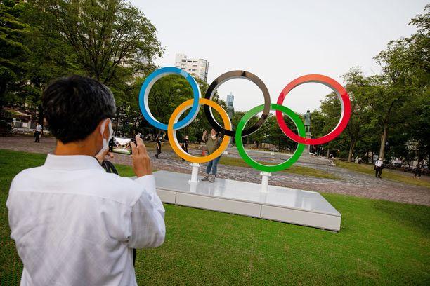 Japanin hallitus järjesti olympiakisojen ympärille valtavan teatterin.