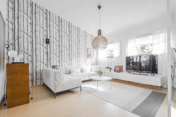 Tämän asunnon sisustuksessa on kyllä jotain hyvin suomalaista.