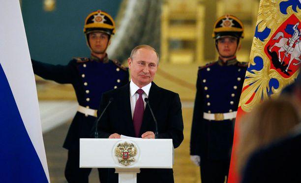 Venäjän näkemys maailman asioista leviää nyt entistä laajemmalle Suomessa. Kuvassa presidentti Vladimir Putin puhumassa Venäjän olympiaurheilijoille.