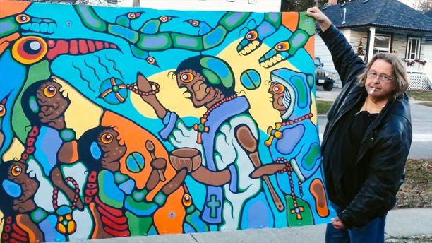 Kuvassa Randy Potter -niminen mies pitelee taideteosta, jonka tekijäksi on väitetty Norval Morrisseauta. Potter huutokauppasi lukuisia vastaavanlaisia maalauksia, muttei liittynyt Gary Lamontin hyväksikäyttörikoksiin millään lailla.