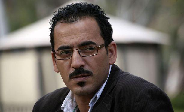 Kidutettujen toimittajien joukossa olivat Feras Killani ja kameramies Goktay Koraltan (alla).