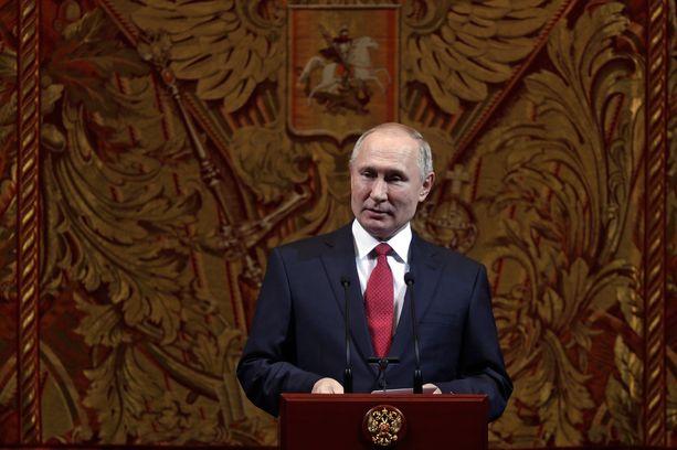 Venäjän presidentti Vladimir Putin puhumassa uuden vuoden gaalassa 26. joulukuuta.