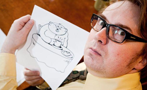 Fingerpori-hahmo ja piirtäjä Pertti Jarla.