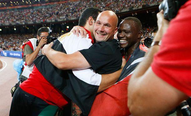 Petteri Piironen ja hänen suojattinsa juhlivat Pekingin MM-kisoissa.