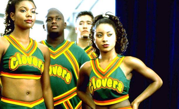 Natina Reed (oik.) näytteli cheerleaderia Anna palaa -hittileffassa vuonna 2000.