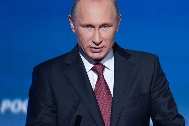 Putin kenties valtansa huipulla vuonna 2014, yli 60-vuotiaanakin harvinaisen silo-otsaisena.